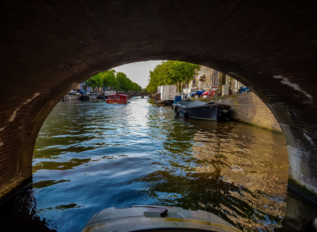 The view under the bridge in Amsterdam canals