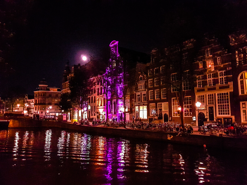 Amsterdam by the canal at the night time