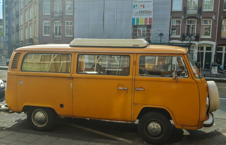 Yellow retro van/camper captured on the streets of Dutch capital-Amsterdam