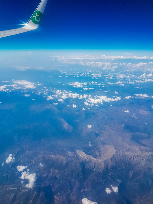Airplane-view-clouds-and-mountains