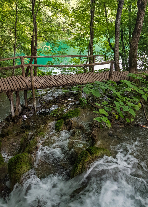 Wonderful and vibrant view on the waterfall and a turquoise lake in Plitvice