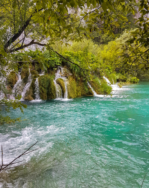 Smaller waterfalls and turquoise lake in Plitvice Lakes National Park