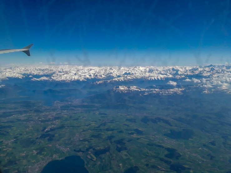Aerial-photo-airplane-view-snowy-mountains