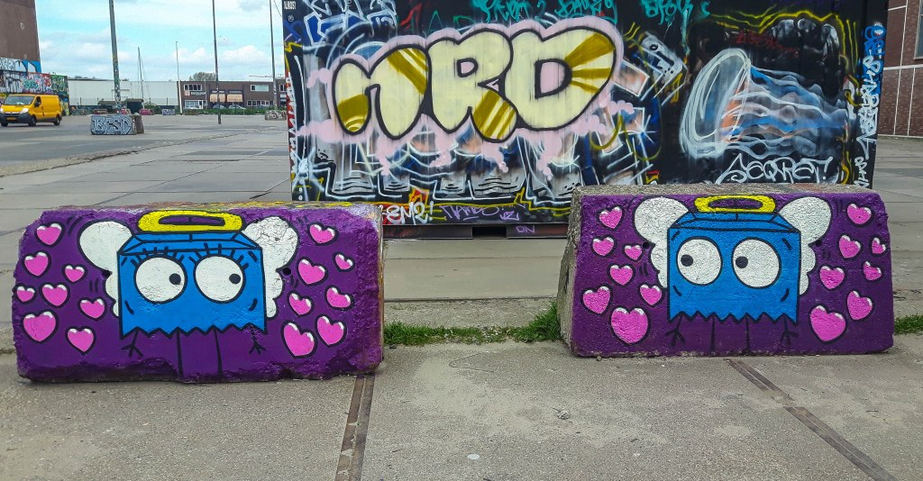 Cute and romantic graffiti art in NDSM are in Amsterdam