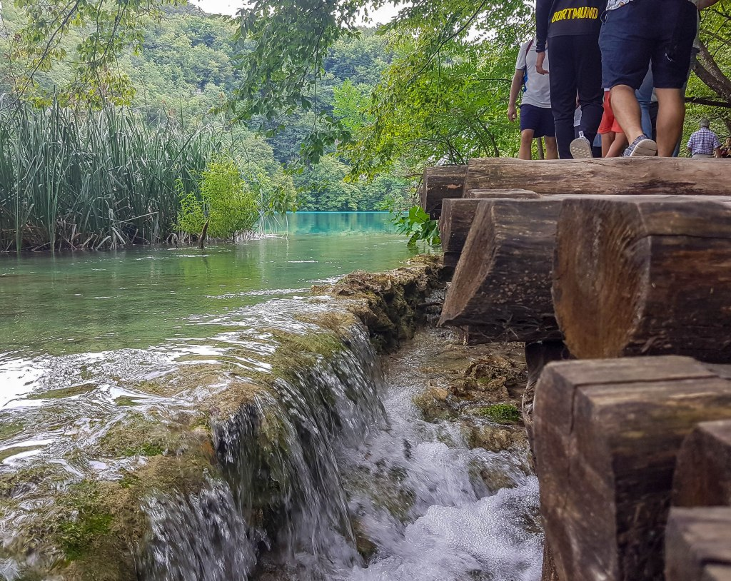 A boardwalk and small waterfalls in Plitvice Lakes Croatia
