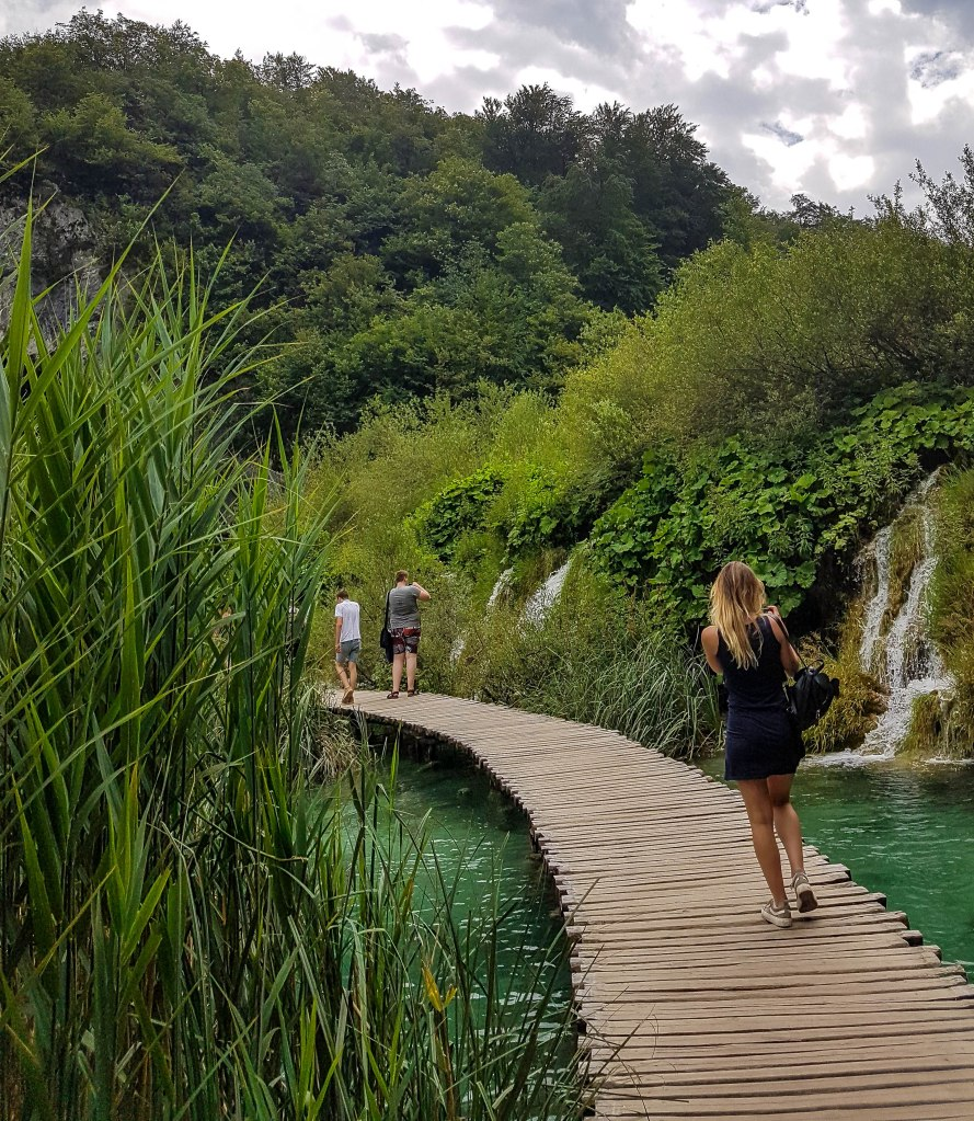 One of the boardwalks in greenery of Plitvice Lakes