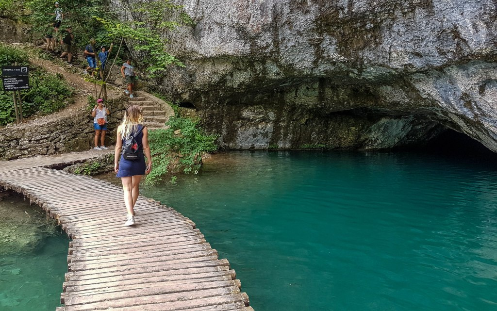 Me walking towards one of the caves of Plitvice Lakes in Croatia