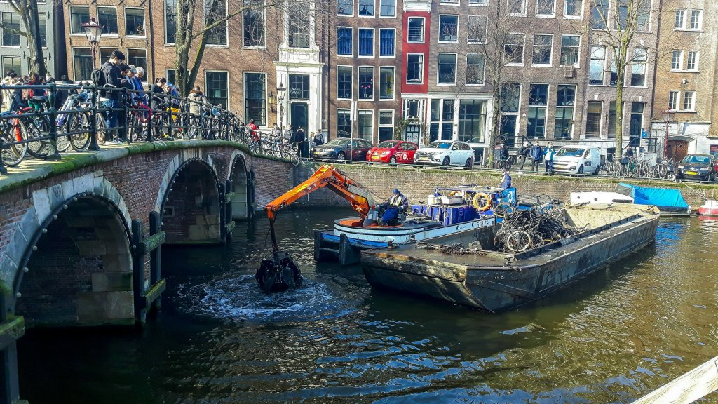 Dutch way of fishing for bikes in canals of Amsterdam