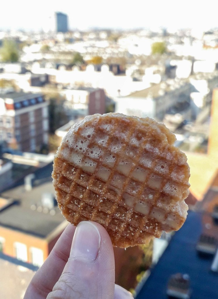 Stroopwafel eating on a rooftop in the Amsterdam city