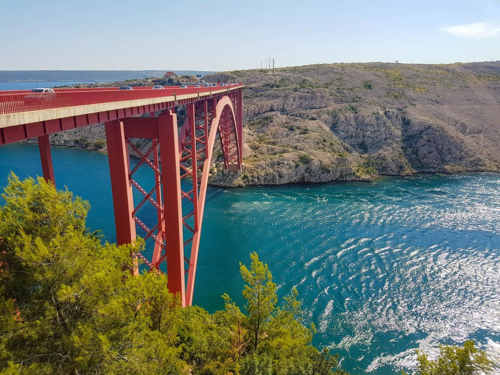 Maslenica bridge in Croatia with Adriatic sea around, cliffs and pine trees