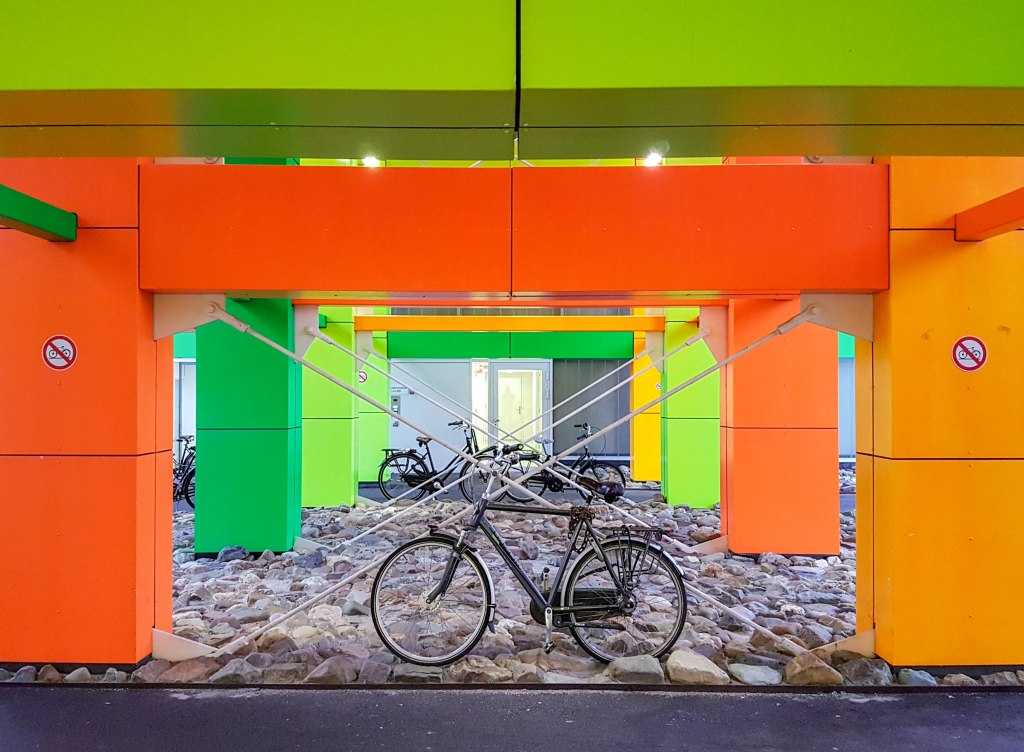 Colorful wall with bikes in Amsterdam