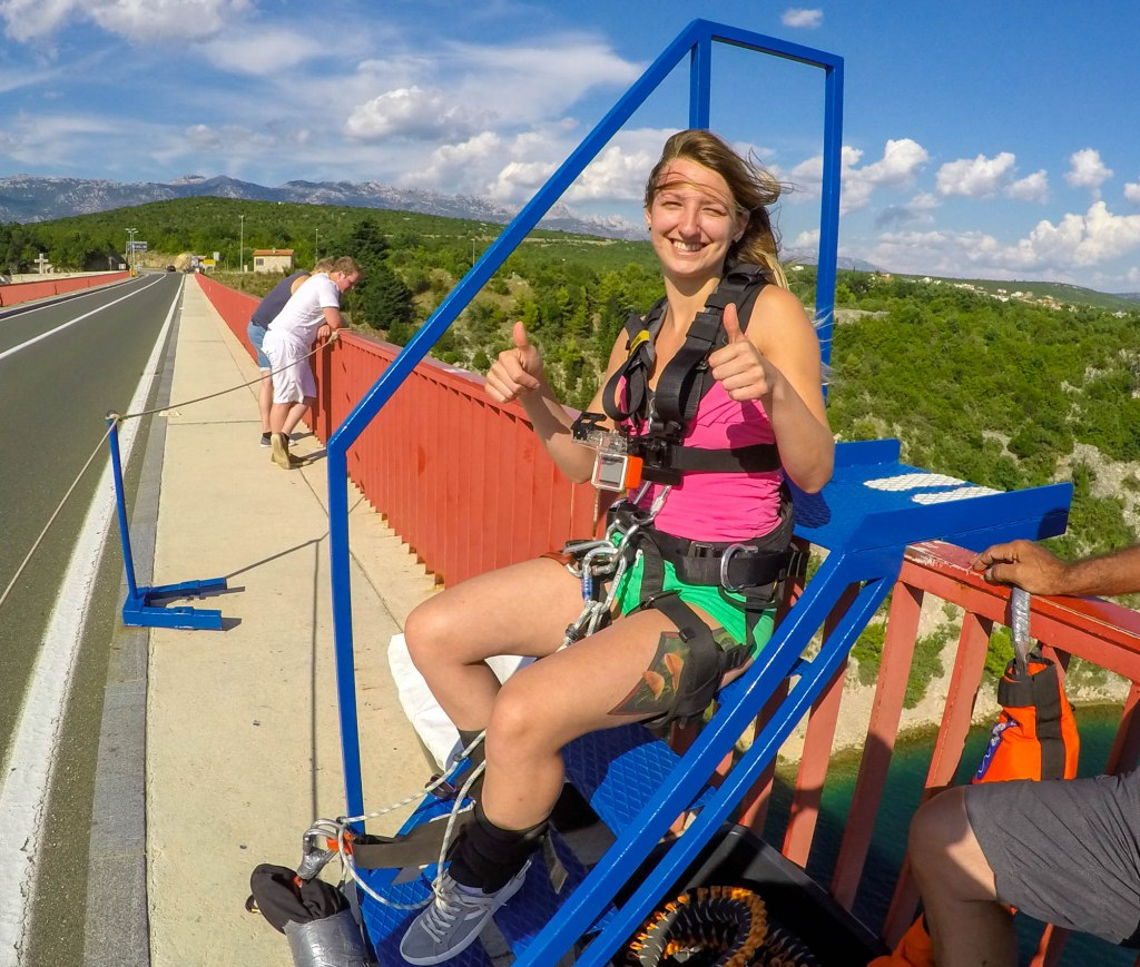 Preparing to bungee jump from Maslenica bridge in Croatia on a beautiful sunny day