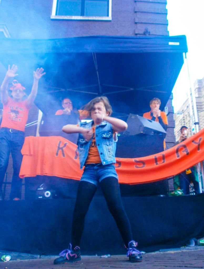 Dancing people on King's Day Amsterdam the Netherlands