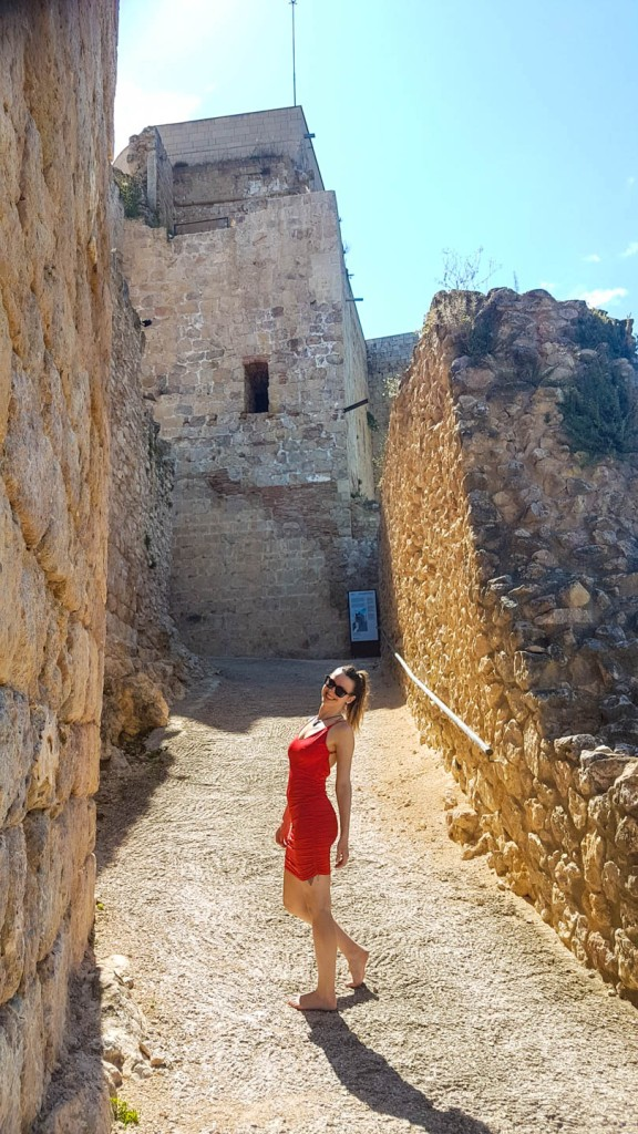 A girl standing on the entrance to Miravet castle