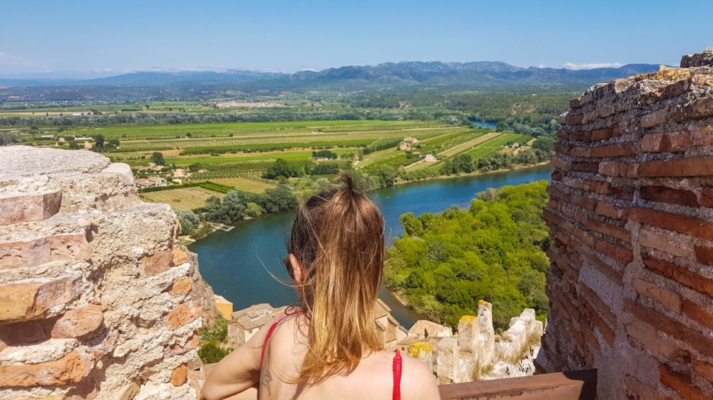 A girl enjoying in epic views over Ebro river from Miravet castle