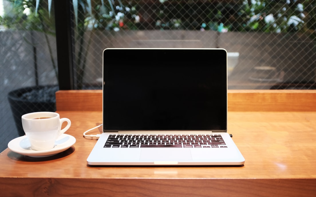 Freelancers gadgets: a laptop and a coffee