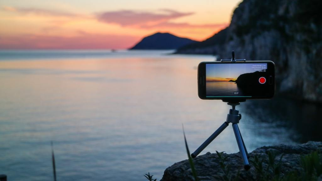A phone on a tripod filming the sunset