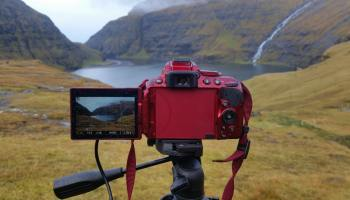 A tripod and a camera filming the landscape
