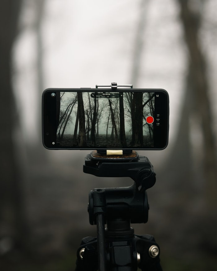 Phone on a tripod standing and shooting