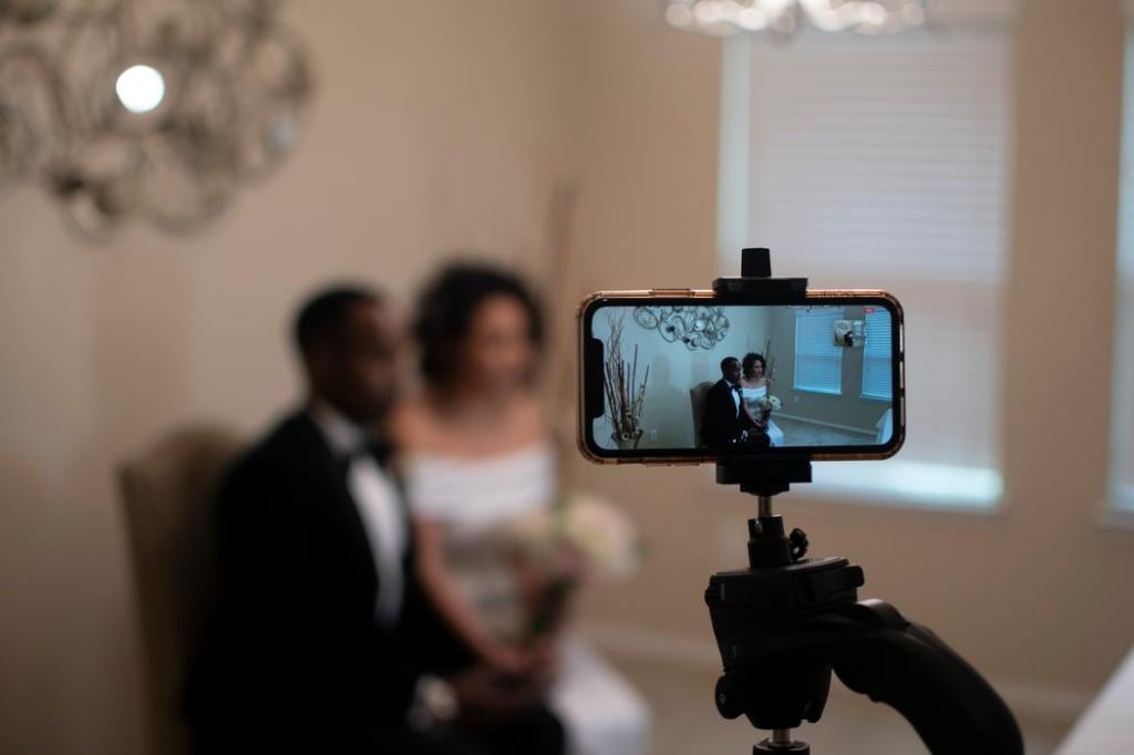 A phone on a tripod shooting a wedding couple