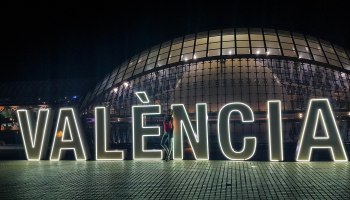 Valencia letters during the night in Spain with a girl on it